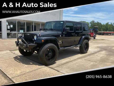 2014 Jeep Wrangler Unlimited for sale at A & H Auto Sales in Clanton AL