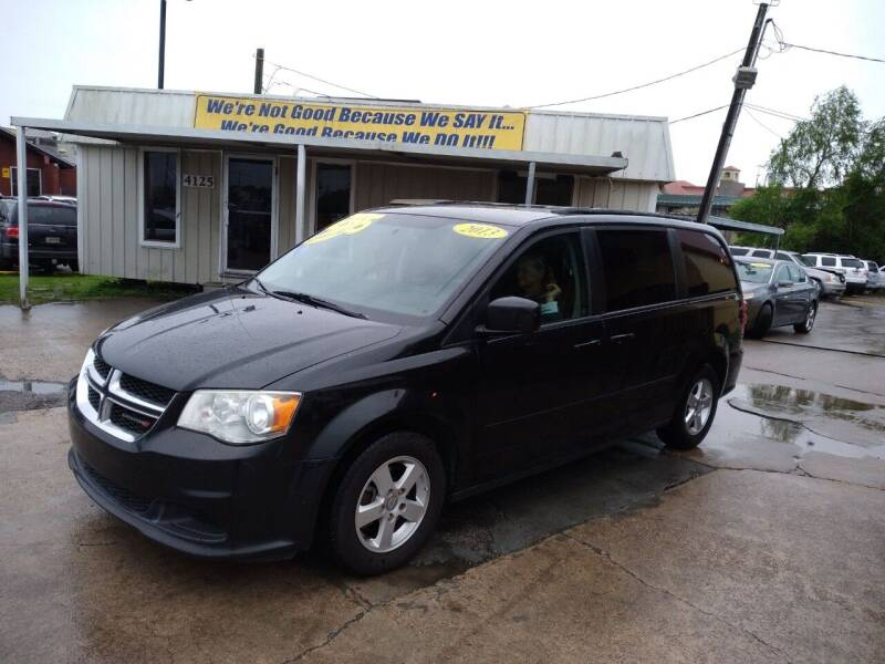 2013 Dodge Grand Caravan for sale at Taylor Trading Co in Beaumont TX