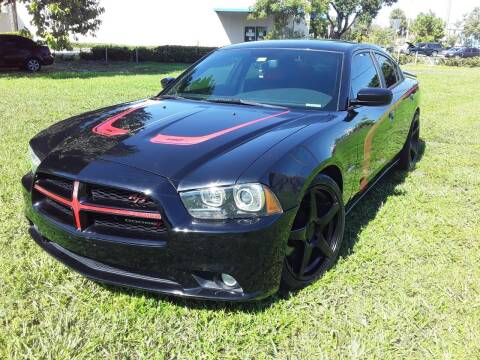 2014 Dodge Charger for sale at YOUR BEST DRIVE in Oakland Park FL