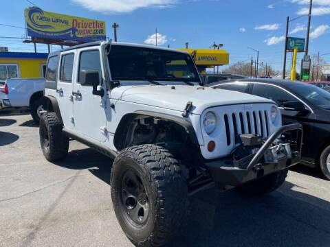 2013 Jeep Wrangler Unlimited for sale at New Wave Auto Brokers & Sales in Denver CO