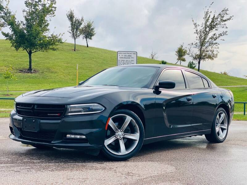 2015 Dodge Charger for sale at AUTO DIRECT in Houston TX