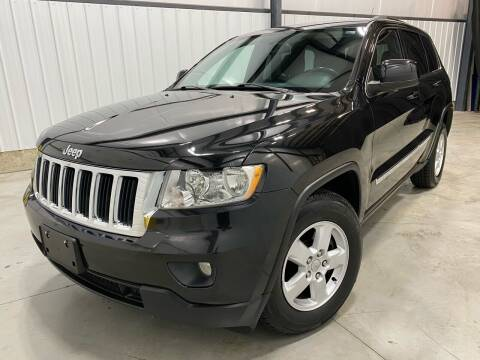 2011 Jeep Grand Cherokee for sale at EUROPEAN AUTOHAUS, LLC in Holland MI