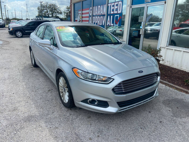 2013 Ford Fusion Hybrid for sale at Lee Auto Group Tampa in Tampa FL