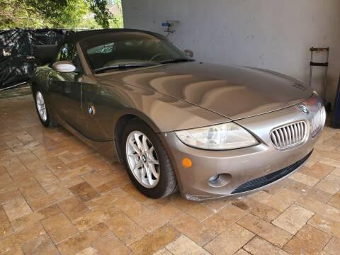 2005 BMW Z4 for sale at America Auto Wholesale Inc in Miami FL