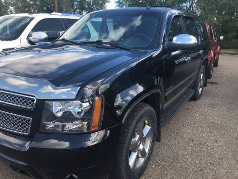 2011 Chevrolet Tahoe for sale at BARNES AUTO SALES in Mandan ND
