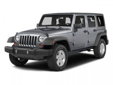 2014 Jeep Wrangler Unlimited for sale at J T Auto Group in Sanford NC