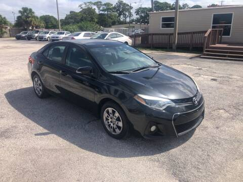 2014 Toyota Corolla for sale at Friendly Finance Auto Sales in Port Richey FL