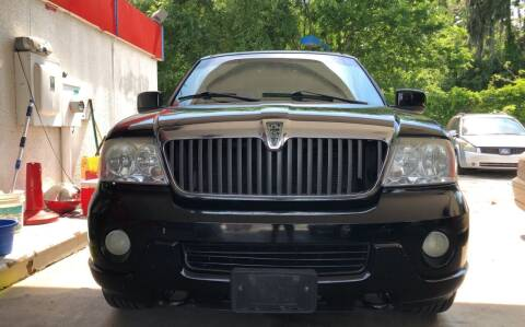 2003 Lincoln Navigator for sale at Louie's Auto Sales in Leesburg FL
