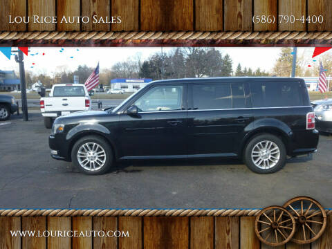 2013 Ford Flex for sale at Lou Rice Auto Sales in Clinton Township MI