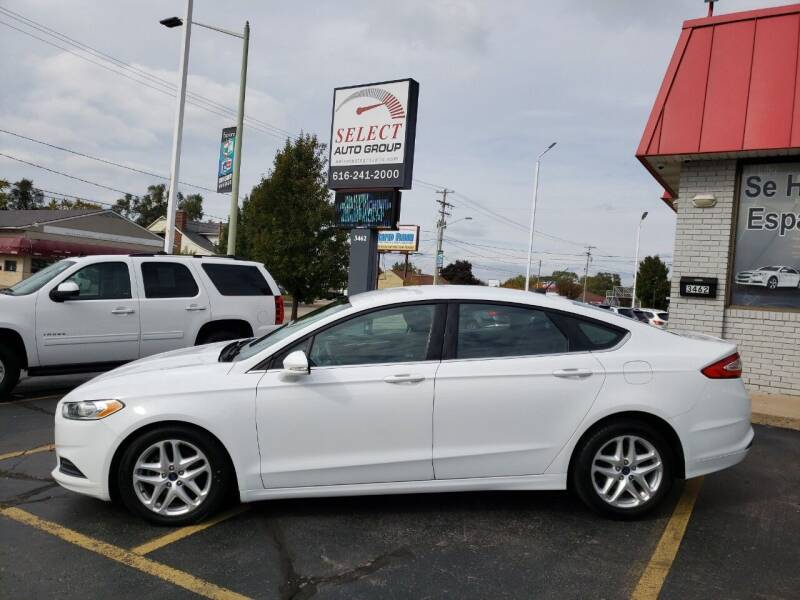 2016 Ford Fusion for sale at Select Auto Group in Wyoming MI