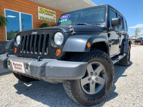 2011 Jeep Wrangler Unlimited for sale at MARIETTA MOTORS LLC in Marietta OH