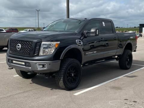 2017 Nissan Titan XD for sale at EA Motorgroup in Austin TX
