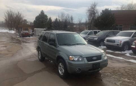 2006 Ford Escape Hybrid for sale at QUEST MOTORS in Englewood CO