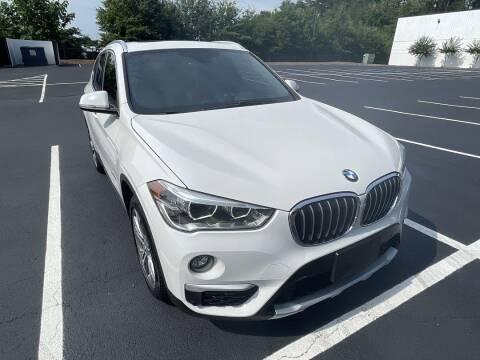 2016 BMW X1 for sale at CU Carfinders in Norcross GA