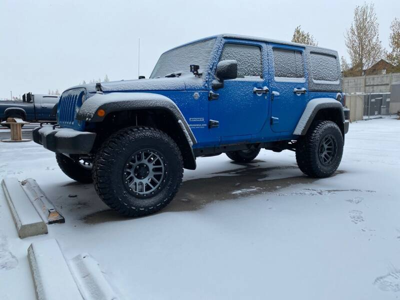 2012 Jeep Wrangler Unlimited for sale at Truck Buyers in Magrath AB