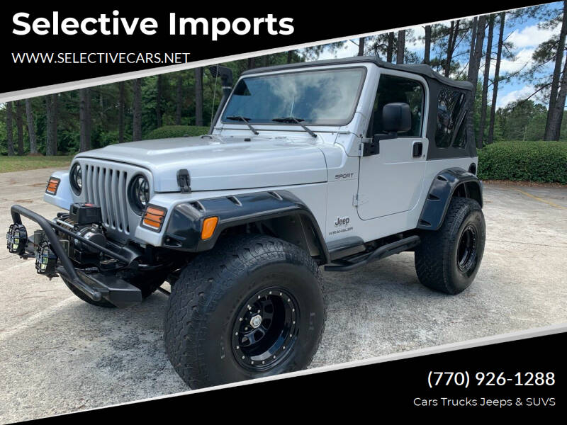 2003 Jeep Wrangler for sale at Selective Imports in Woodstock GA