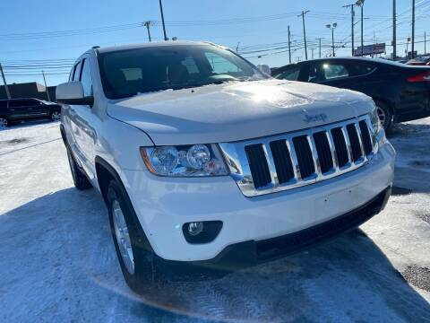 2012 Jeep Grand Cherokee for sale at M-97 Auto Dealer in Roseville MI