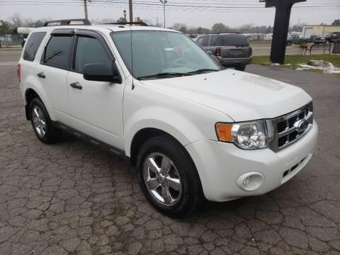 2009 Ford Escape for sale at Van Kalker Motors in Grand Rapids MI