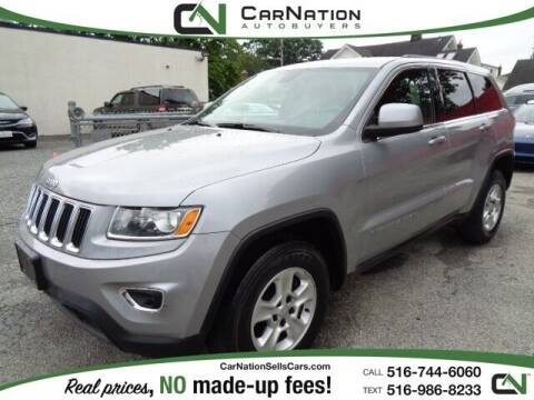 2014 Jeep Grand Cherokee for sale at CarNation AUTOBUYERS Inc. in Rockville Centre NY