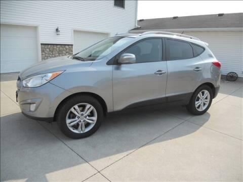 2013 Hyundai Tucson for sale at OLSON AUTO EXCHANGE LLC in Stoughton WI