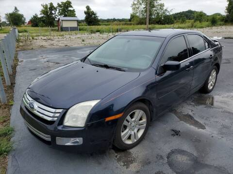 2009 Ford Fusion for sale at HEDGES USED CARS in Carleton MI