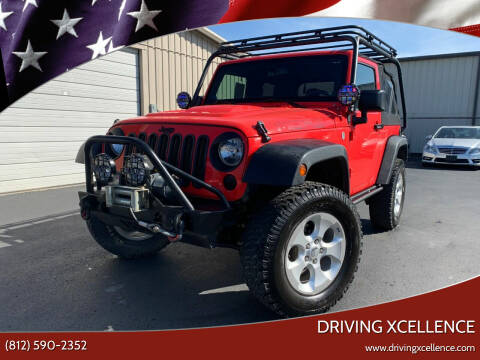 2013 Jeep Wrangler for sale at Driving Xcellence in Jeffersonville IN