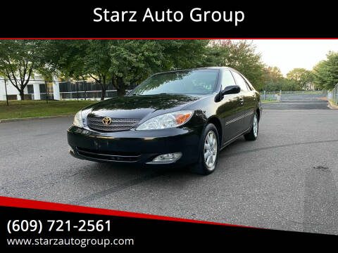2003 Toyota Camry for sale at Starz Auto Group in Delran NJ