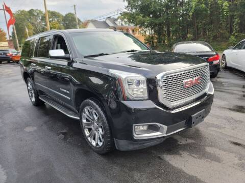 2015 GMC Yukon XL for sale at GEORGIA AUTO DEALER, LLC in Buford GA