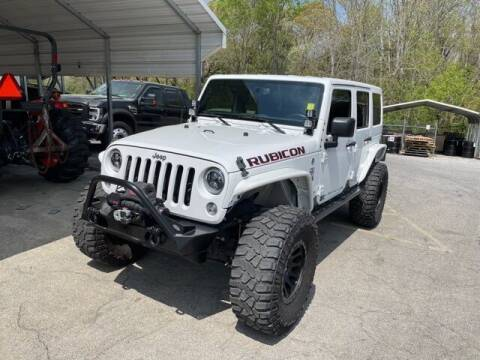 2016 Jeep Wrangler Unlimited for sale at BILLY HOWELL FORD LINCOLN in Cumming GA