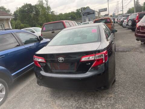 2013 Toyota Camry for sale at Tiger Auto Sales in Columbus OH