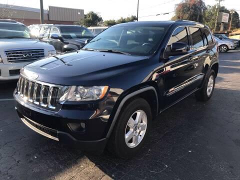 2011 Jeep Grand Cherokee for sale at Magic Motors Inc. in Snellville GA