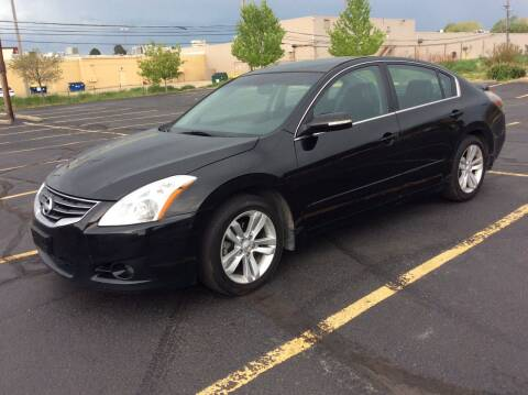 2012 Nissan Altima for sale at AROUND THE WORLD AUTO SALES in Denver CO