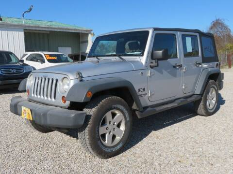 2009 Jeep Wrangler Unlimited for sale at Low Cost Cars in Circleville OH