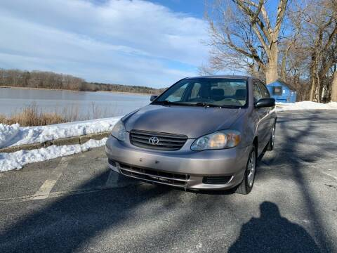 2003 Toyota Corolla for sale at MCQ SALES INC in Upton MA