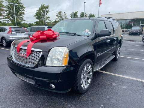 2010 GMC Yukon XL for sale at Charlotte Auto Group, Inc in Monroe NC