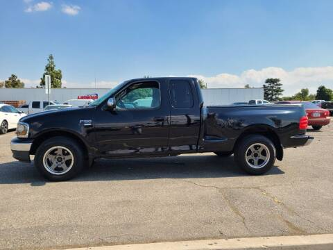 2002 Ford F-150 for sale at E and M Auto Sales in Bloomington CA