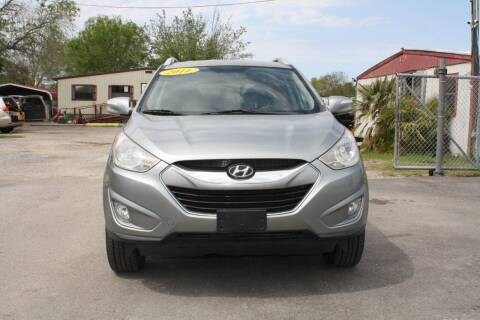 2011 Hyundai Tucson for sale at Fabela's Auto Sales Inc. in Dickinson TX