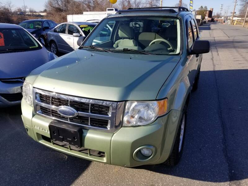 2008 Ford Escape for sale at Howe's Auto Sales in Lowell MA