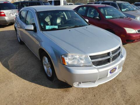 2010 Dodge Avenger for sale at BERG AUTO MALL & TRUCKING INC in Beresford SD