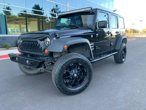 2013 Jeep Wrangler Unlimited for sale at San Diego Auto Solutions in Escondido CA