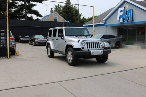 2012 Jeep Wrangler Unlimited for sale at F & M AUTO SALES in Detroit MI