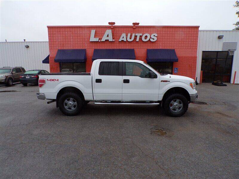 2011 Ford F-150 for sale at L A AUTOS in Omaha NE