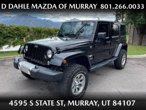 2014 Jeep Wrangler Unlimited for sale at D DAHLE MAZDA OF MURRAY in Salt Lake City UT