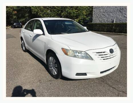 2009 Toyota Camry for sale at Select Auto in Smithtown NY