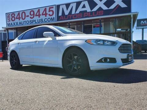 2014 Ford Fusion for sale at Maxx Autos Plus in Puyallup WA