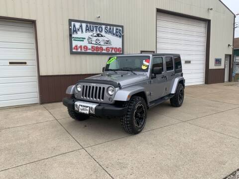 2015 Jeep Wrangler Unlimited for sale at A-1 AUTO SALES in Mansfield OH