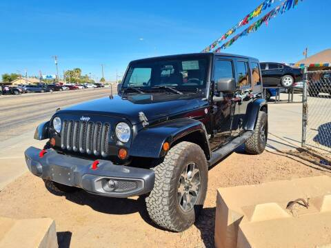 2009 Jeep Wrangler Unlimited for sale at A AND A AUTO SALES in Gadsden AZ