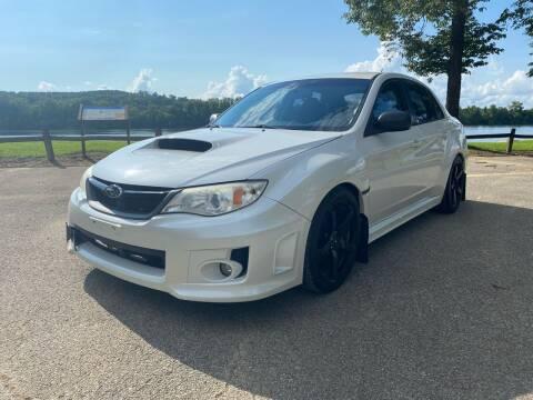 2014 Subaru Impreza for sale at Monroe Auto's, LLC in Parsons TN