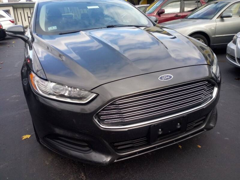2015 Ford Fusion for sale at MIRACLE AUTO SALES in Cranston RI