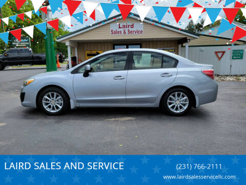 2013 Subaru Impreza for sale at LAIRD SALES AND SERVICE in Muskegon MI